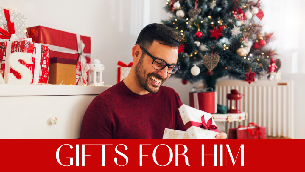 Man in glasses smiling at Christmas present.